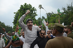 July 29, 2017 - Lahore, Punjab, Pakistan - Pakistani protesters celebrate the decision by the Supreme Court of Pakistan to disqualify PM Nawaz Sharif.. (Credit Image: © Rana Sajid Hussain/Pacific Press via ZUMA Wire)