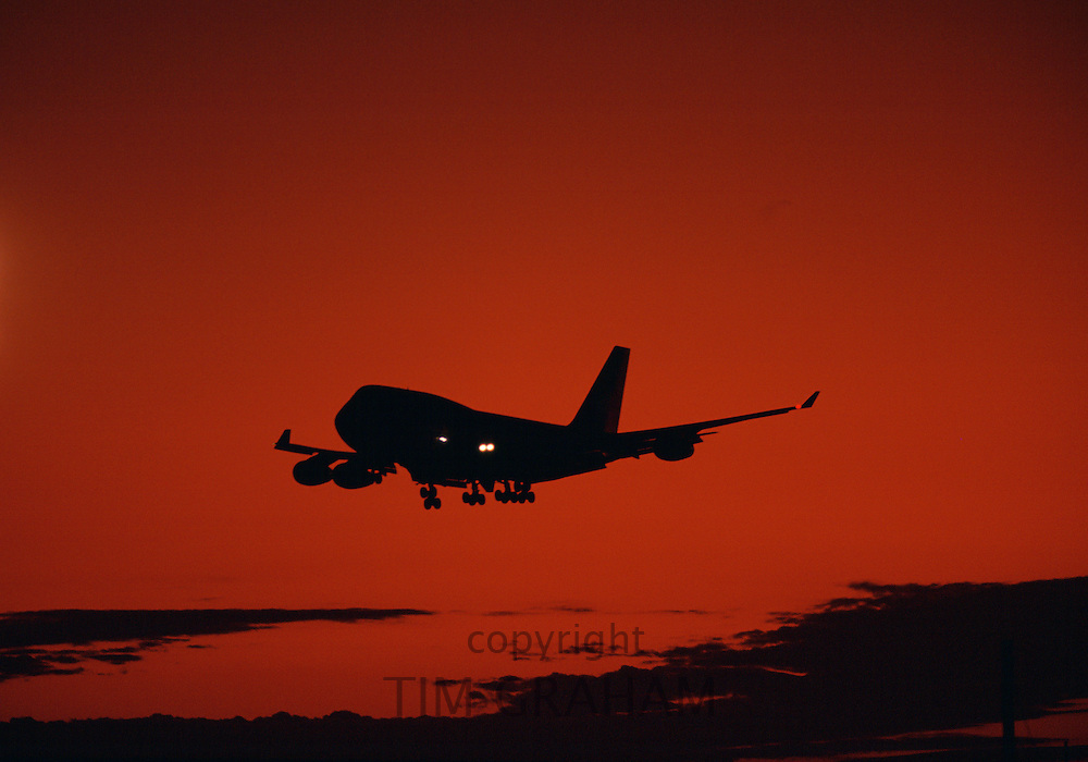 Boeing 747 Jumbo Jet lands at sunset in Australia