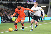 Millwall defender Mahlon Romeo and Derby County forward Martyn Waghorn challenge for the ball during the EFL Sky Bet Championship match between Derby County and Millwall at the Pride Park, Derby, England on 20 February 2019.
