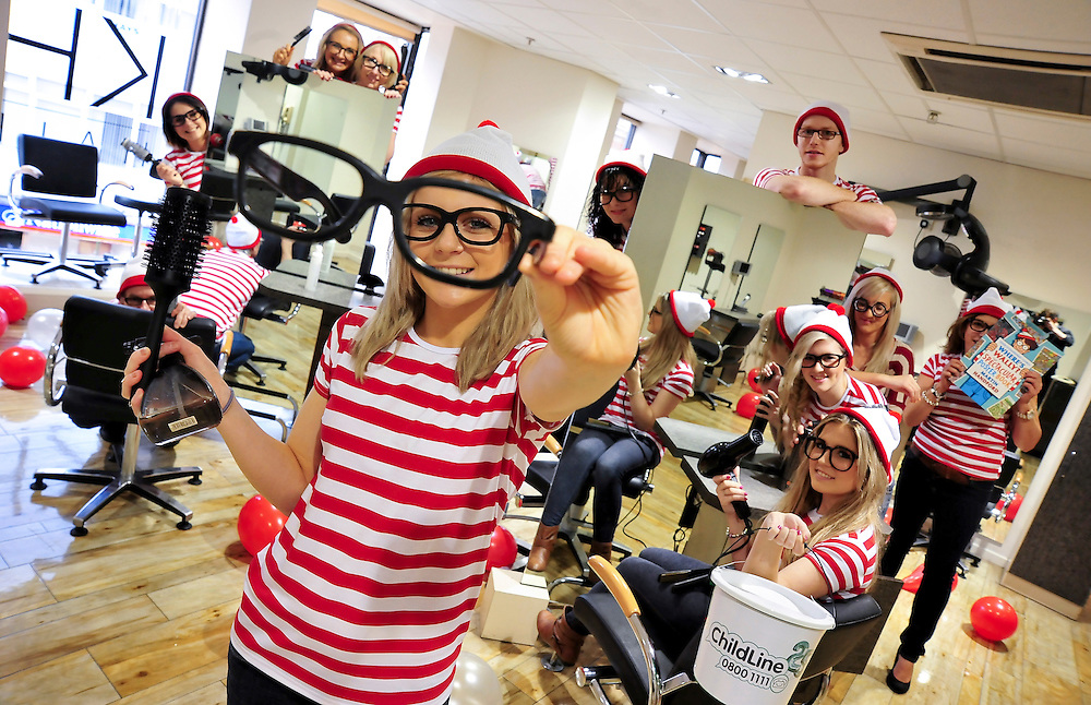 This bunch of Wallies at KH Hair in Westfield Derby did their bit to help raise money for ChildLine, by dressing up as the famous children's character from the Where's Wally? books. The group of hairdressers also had a selection of cakes and sweets available for their clients, all in return for a small donation. Pictured in the foreground is Chloe Burrell, aged 18.