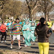 Runners in the 2013 Cherry Blossom 10-Mile Run. Scheduled to coincide with the National Cherry Blossom Festival in early spring, the race takes runners along the National Mall and by the famous cherry blossoms around the Tidal Basin. Some of the runners, like these two in center of frame, run in costume.