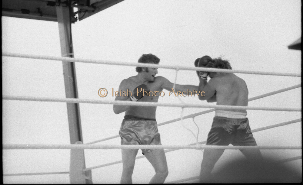Ali vs Lewis Fight, Croke Park,Dublin.<br /> 1972.<br /> 19.07.1972.<br /> 07.19.1972.<br /> 19th July 1972.<br /> As part of his built up for a World Championship attempt against the current champion, 'Smokin' Joe Frazier,Muhammad Ali fought Al 'Blue' Lewis at Croke Park,Dublin,Ireland. Muhammad Ali won the fight with a TKO when the fight was stopped in the eleventh round.<br /> <br /> Picture shows Bugner landing a flurry of punches to an overwhelmed Neilson.
