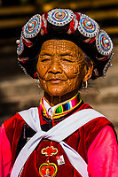 A woman of the Naxi ethnic minority dancing in the Old Town (Dayan) of Lijiang, Yunnan Province, China. The Old Town is a UNESCO World Heritage Site.