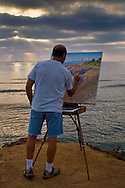 Artist Bill Jewell plein aire painting on coastal bluff overlooking  the ocean at Sunset Cliffs,  San Diego, California
