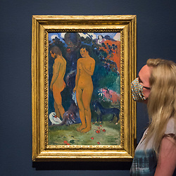 "© Licensed to London News Pictures. 04/08/2020. LONDON, UK. A staff member poses with ""Adam and Eve"", 1902, by Paul Gauguin. Preview of ""Gauguin and the Impressionists : Masterpieces from the Ordrupgaard Collection"" at the Royal Academy of Arts in Piccadilly.  60 works from a collection of Impressionist paintings, assembled by wealthy Danish couple Wilhelm and Henny Hansen, are on show 7 August to 18 October 2020, and includes masterpieces by Gauguin, Degas, Monet, Morisot, Pissarro, Renoir and Sisley.  Photo credit: Stephen Chung/LNP"