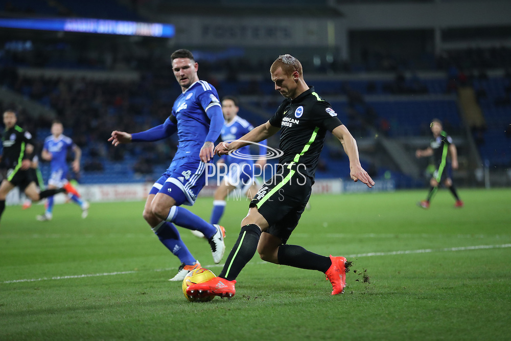 Brighton & Hove Albion central midfielder Steve Sidwell (14) crosses the ball during the EFL Sky Bet Championship match between Cardiff City and Brighton and Hove Albion at the Cardiff City Stadium, Cardiff, Wales on 3 December 2016.