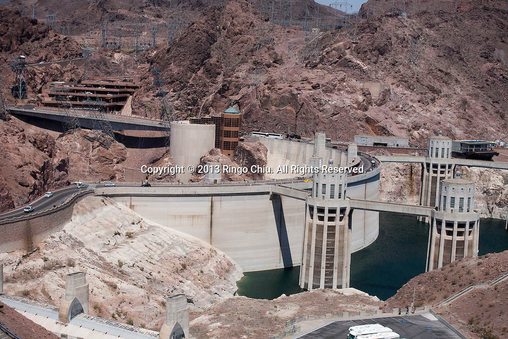 Hoover Dam, also known as Boulder Dam, is a concrete gravity-arch dam in the Black Canyon of the Colorado River, on the border between the U.S. states of Arizona and Nevada. The dam, located 30 miles (48 km) southeast of Las Vegas, is named after Herbert Hoover, who played an instrumental role in its construction, first as Secretary of Commerce and then later as President of the United States. Construction began in 1931 and was completed in 1935, more than two years ahead of schedule. The dam and the power plant are operated by the Bureau of Reclamation of the U.S. Department of the Interior. Listed on the National Register of Historic Places in 1981, Hoover Dam was designated a National Historic Landmark in 1985. (Photo by Ringo Chiu/PHOTOFORMULA.com)