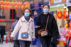 © Licensed to London News Pictures. 29/01/2020. London, UK. Women are seen in London's Chinatown wearing face masks following the outbreak of Coronavirus in Coronavirus in Wuhan, China which has killed 132 people and infected more than 6,000. According to the Department of Heath, 97 people have been tested for Coronavirus in the UK and all have been confirmed negative.   Photo credit: Dinendra Haria/LNP