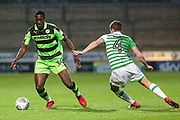 Forest Green Rovers Isaiah Osbourne(34) is challenged by Yeovil Town's Jared Bird(4) during the EFL Sky Bet League 2 match between Yeovil Town and Forest Green Rovers at Huish Park, Yeovil, England on 24 April 2018. Picture by Shane Healey.
