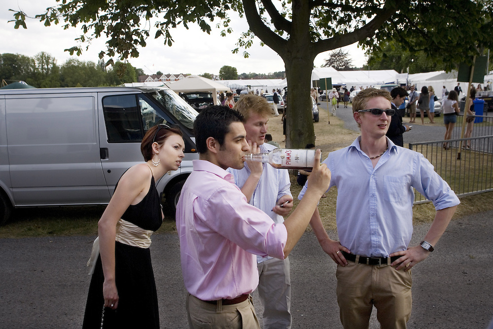 UK. Henley on Thames. Young drinkers at Henley Regatta
