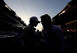Mercedes' Lewis Hamilton speak to one of his engineers before the Abu Dhabi Grand Prix at the Yas Marina Circuit, Abu Dhabi.