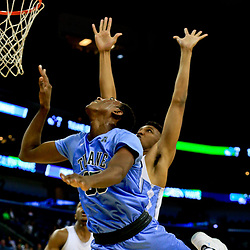 Nov 11, 2016; New Orleans, LA, USA; Tulane Green Wave guard Melvin Frazier (35) shoots over North Carolina Tar Heels guard Brandon Robinson (14) during the first quarter of a game at the Smoothie King Center. Mandatory Credit: Derick E. Hingle-USA TODAY Sports
