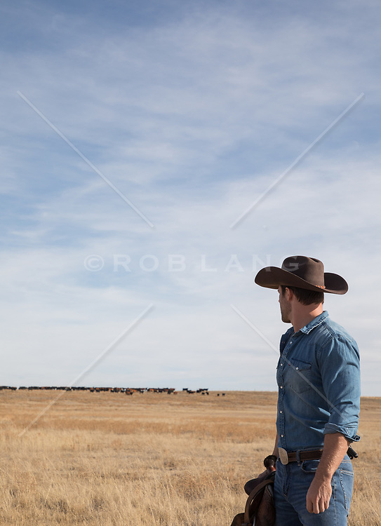 cowboy looking out towards a ranch