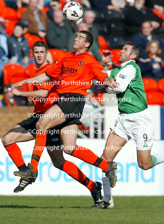 Dundee United v Hibs  07.04.02<br />Jim Lauchlan beats Craig Brewster to the ball as David McCracken looks on<br /><br />Pic by Graeme Hart<br />Copyright Perthshire Picture Agency<br />Tel: 01738 623350 / 07990 594431