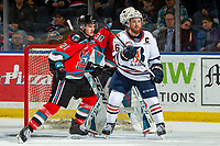 KELOWNA, BC - OCTOBER 12: Zane Franklin #16 of the Kamloops Blazers is checked by Jake Lee #21 in front of the net of Roman Basran #30 of the Kelowna Rockets during third period at Prospera Place on October 12, 2019 in Kelowna, Canada. (Photo by Marissa Baecker/Shoot the Breeze)