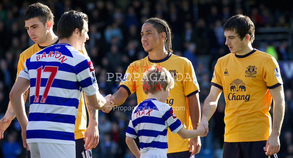 LONDON, ENGLAND - Saturday, March 3, 2012: Everton's Steven Pienaar shakes hands with Queens Park Rangers' captain Joey Barton before the Premiership match at Loftus Road. (Pic by Vegard Grott/Propaganda)