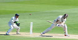 Surrey's Kevin Pietersen reverse sweeps the ball. - Photo mandatory by-line: Harry Trump/JMP - Mobile: 07966 386802 - 22/04/15 - SPORT - CRICKET - LVCC County Championship - Division 2 - Day 4 - Glamorgan v Surrey - Swalec Stadium, Cardiff, Wales.