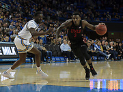 Nov 15, 2019; Los Angeles, CA, USA; UNLV Rebels guard Amauri Hardy (3) is defended by UCLA Bruins guard Prince Ali (23) in the first half at Pauley Pavilion. UCLA defeated UNLV 71-54.