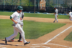 17 April 2016:  John Bosco scores on a hit by Ben Manski during an NCAA division 3 College Conference of Illinois and Wisconsin (CCIW) Pay in Baseball game during the Conference Championship series between the North Central Cardinals and the Illinois Wesleyan Titans at Jack Horenberger Stadium, Bloomington IL