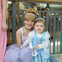 Libby Ezell | BUY at PHOTOS.DJOURNAL.COM<br /> Lillie Jarvis, 2, poses with Cinderella, Gabby Bass, one of the many Disney Princesses at Saturday's NEWMS Chocolate Festival