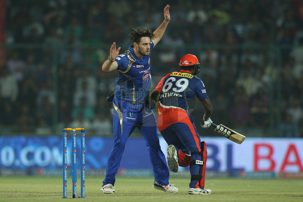 Mitchell McClenaghan of the Mumbai Indians and Angelo Mathews of the Delhi Daredevils in action during match 21 of the Pepsi IPL 2015 (Indian Premier League) between The Delhi Daredevils and The Mumbai Indians held at the Ferozeshah Kotla stadium in Delhi, India on the 23rd April 2015.<br /> <br /> Photo by:  Deepak Malik / SPORTZPICS / IPL