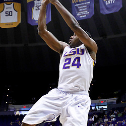 December 15, 2011; Baton Rouge, LA; LSU Tigers forward Storm Warren (24) shoots against the UC Irvine Anteaters during the first half of a game at the Pete Maravich Assembly Center.  Mandatory Credit: Derick E. Hingle-US PRESSWIRE