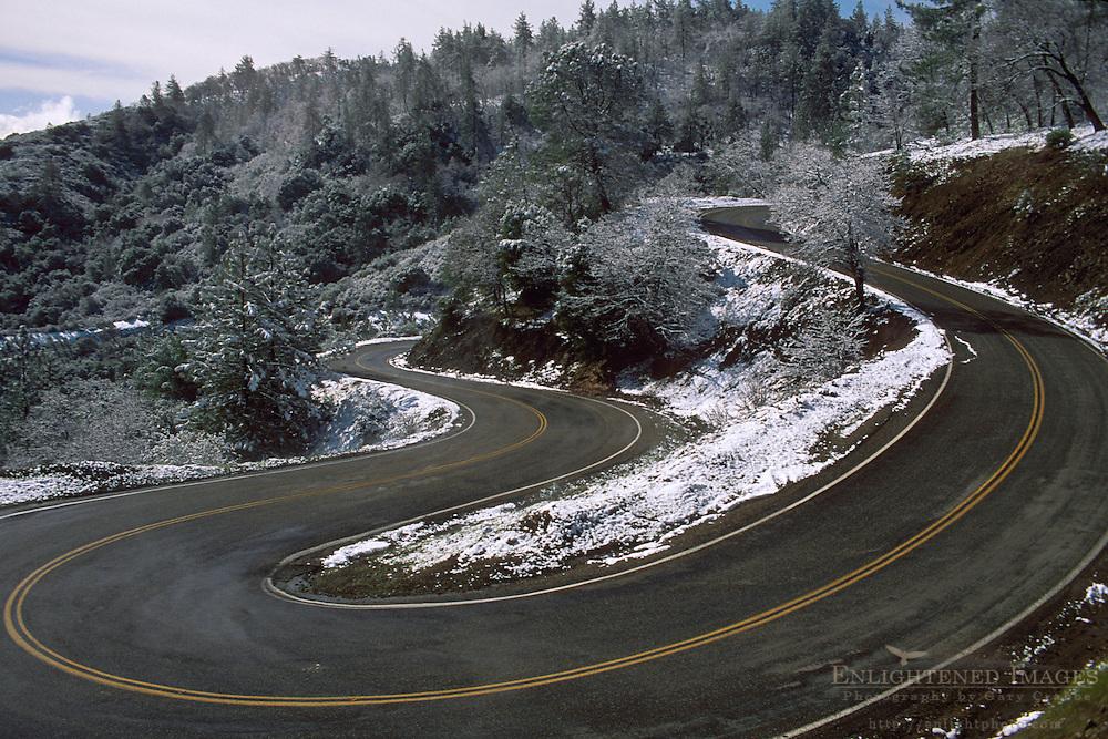Snow along twisting curves of two lane mountain road, Mount Hamilton, Santa Clara County, California