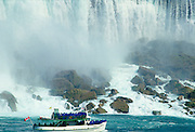 Tourists in waterproof capes on Maid of the Mist tourist boat at Niagara Falls,  Canada