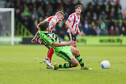 Forest Green Rovers Darren Carter(12) is fouled by Lincoln City's Alan Power who is shown a yellow card, booked during the Vanarama National League match between Forest Green Rovers and Lincoln City at the New Lawn, Forest Green, United Kingdom on 19 November 2016. Photo by Shane Healey.