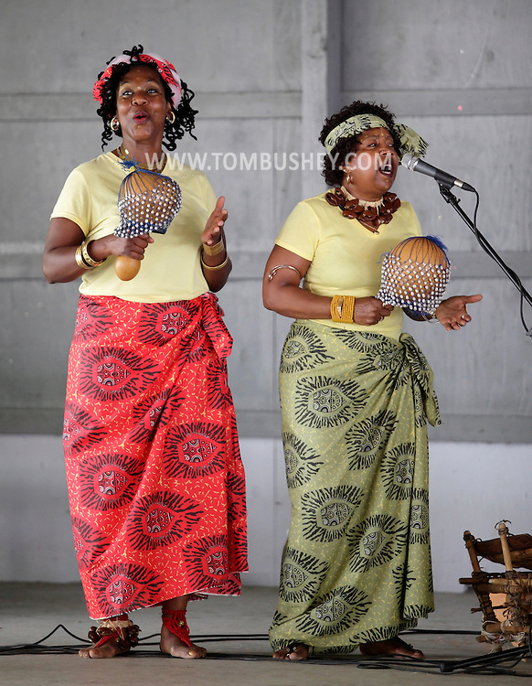 Hamptonburgh, New York - Two members of the Sankofa Drum and Dance Ensemble perform with a calabash gourds at the fourth annual Earth & Water Festival at Thomas Bull Memorial Park on June 4, 2011.