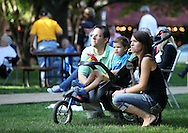 Robert Brooks (from left), Owen Brooks, 3, and Dana Brooks, all of Cedar Rapids, enjoy the music by The Silver Wings at the Swamp Fox Festival Picnic In the Park at Marion Square Park in Marion, on Friday, September 9, 2011.