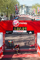 Marcel Hug of Switzerland crosses the finishing line in a time of 01:32:41 to win the Men's Wheelchair race ahead of David Weir of Great Britain at the Virgin Money London Marathon 2014 at the finish line on Sunday 13 April 2014<br /> Photo: Dillon Bryden/Virgin Money London Marathon<br /> media@london-marathon.co.uk
