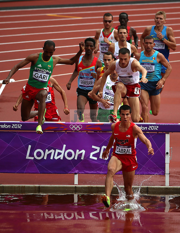 Donald Cabral of the USA leads the pack during a heat for the men's 3000m Steeplechase during track and field at the Olympic Stadium during day 6 of the London Olympic Games in London, England, United Kingdom on August 3, 2012..(Jed Jacobsohn/for The New York Times)..