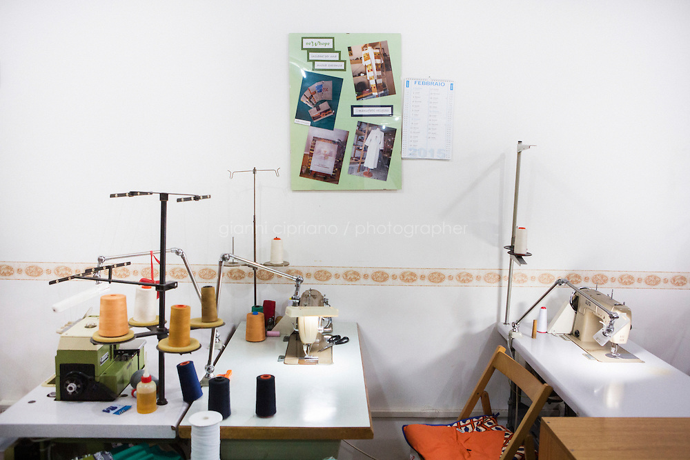 CASERTA, ITALY - 25 FEBRUARY 2015: Sewing workspaces at the New Hope tailor's shop, where ex-sex workers work in Caserta, Italy, on February 25th 2015.<br /> <br /> New Hope is an ethnic tailor's shop that makes a variety of colourful products working mainly african fabrics. The New Hope social cooperative, founded in 2014, promotes a training workshop for your immigrant women, many of which have children, that want to integrate in Italian society.