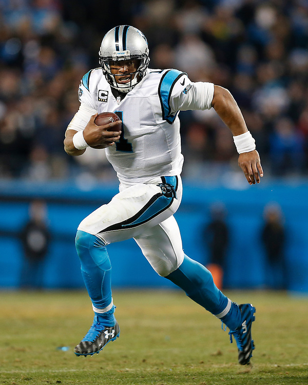 CHARLOTTE, NC - JAN 24:  Quarterback Cam Newton #1 of the Carolina Panthers scrambles during the NFC Championship game against the Arizona Cardinals at Bank of America Stadium on January 24, 2016 in Charlotte, North Carolina.