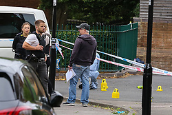 © Licensed to London News Pictures. 04/07/2020. London, UK. Detectives on Roman Way, Islington in north London as police launch a murder investigation following fatal shooting. Police were called at at 3.20pm to Roman Way, following reports of shots fired.  Officers attended with LAS and found a man, believed to be aged in his early 20s, suffering from gunshot injuries. Despite their best efforts, he was pronounced dead at the scene. Photo credit: Dinendra Haria/LNP