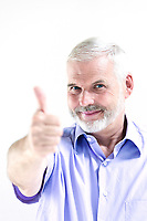 caucasian senior man portrait thumb up success isolated studio on white background