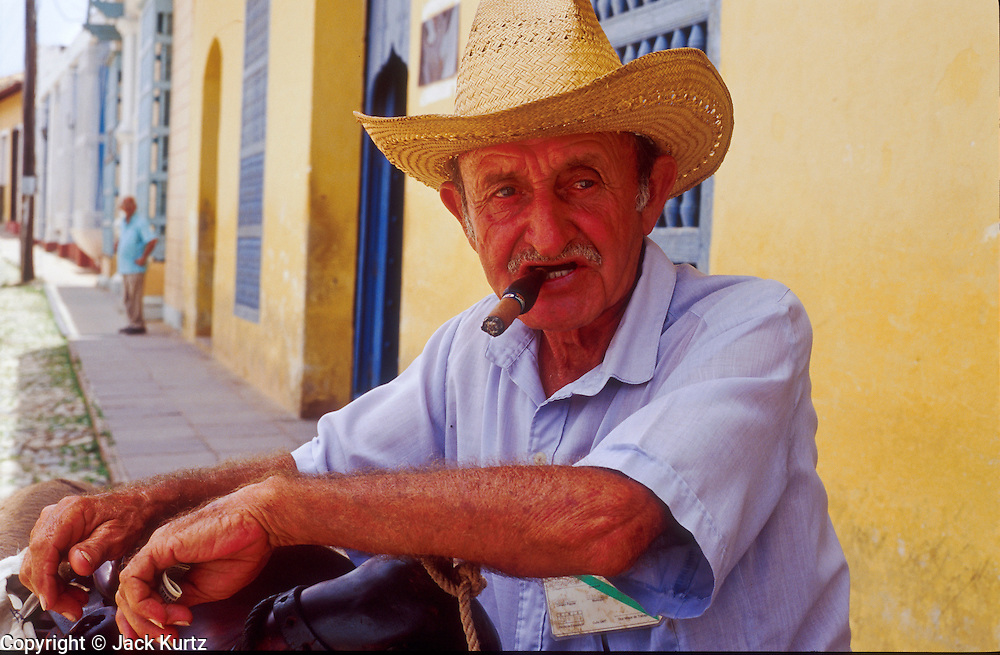 23 JULY 2002 - TRINIDAD, SANCTI SPIRITUS, CUBA: A guajiro or peasant farmer in the colonial city of Trinidad, province of Sancti Spiritus, Cuba, July 23, 2002. Trinidad is one of the oldest cities in Cuba and was founded in 1514. .PHOTO BY JACK KURTZ