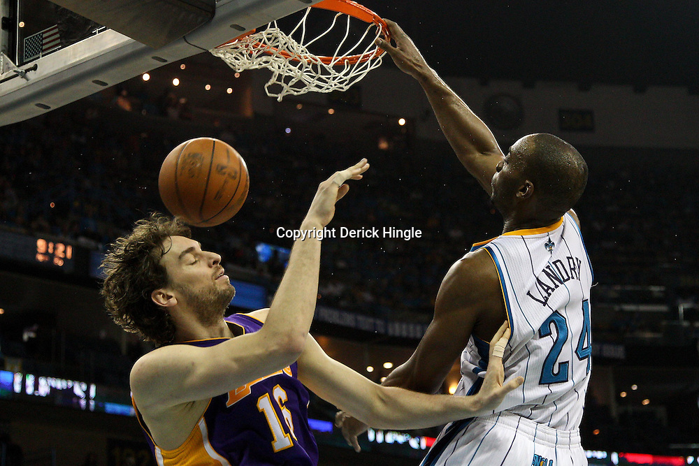 April 28, 2011; New Orleans, LA, USA; New Orleans Hornets power forward Carl Landry (24) dunks over Los Angeles Lakers power forward Pau Gasol (16) during the fourth quarter in game six of the first round of the 2011 NBA playoffs at the New Orleans Arena. The Lakers defeated the Hornets 98-80 to advance to the second round of the playoffs.   Mandatory Credit: Derick E. Hingle