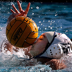 Los Altos Melissa Reynoso,15, Left, is hit in the face with the ball as she tries to control it against San Marino's Lauren Schlerf ,21, Right, in the 3rd period. Los Altos vs San Marino in CIF prep waterpolo playoff action at San Marino February 14. 2006. San Marino beat Los Altos 9-5.