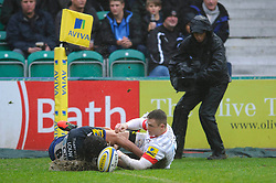 Saracens Winger (#14) Chris Ashton touches the ball down over the line as Bath Flanker (#6) Francois Louw defends but the try is diasaalowed during the first half of the match - Photo mandatory by-line: Rogan Thomson/JMP - Tel: Mobile: 07966 386802 22/12/2012 - SPORT - RUGBY - The Recreation Ground - Bath. Bath Rugby v Saracens - Aviva Premiership.