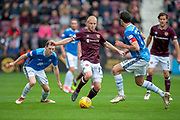 Steven Naismith (#14) of Heart of Midlothian takes on Joe Shaughnessy (#5) of St Johnstone FC during the Ladbrokes Scottish Premiership match between Heart of Midlothian and St Johnstone at Tynecastle Stadium, Gorgie, Scotland on 29 September 2018.
