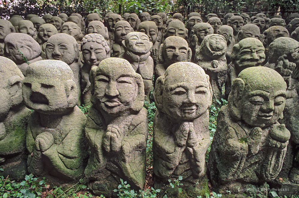Stone statues grouped together on the grounds of Atago Nembutsu-ji (temple) in Sagano district, Kyoto, Japan