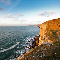A view from a high point over cliff tops and sea shore in England