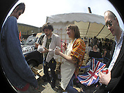 OLIVER GARBAY, SARA LUCAS, AND MICHAEL CLARK WITH A SARA LUCAS MUG, The Art Car Boot Fair, Truman Brewery, Brick Lane. London. 4 June 2006. ONE TIME USE ONLY - DO NOT ARCHIVE  © Copyright Photograph by Dafydd Jones 66 Stockwell Park Rd. London SW9 0DA Tel 020 7733 0108 www.dafjones.com