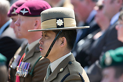 © Licensed to London News Pictures. 11/06/2015. National Memorial Arboretum, Alrewas, Staffordshire, UK. The service to mark the Rededication of the Bastion Memorial. The memorial was begun in Helmand Province in 2006, deconstructed in 2014 and now replicated at the National Memorial Arboretum in Staffordshire. Around two thousand people took part in the service including HRH Prince Harry, the Prime Minister David Cameron and senior members of the Armed Forces. Pictured, a Gurkha at the service. Photo credit : Dave Warren/LNP