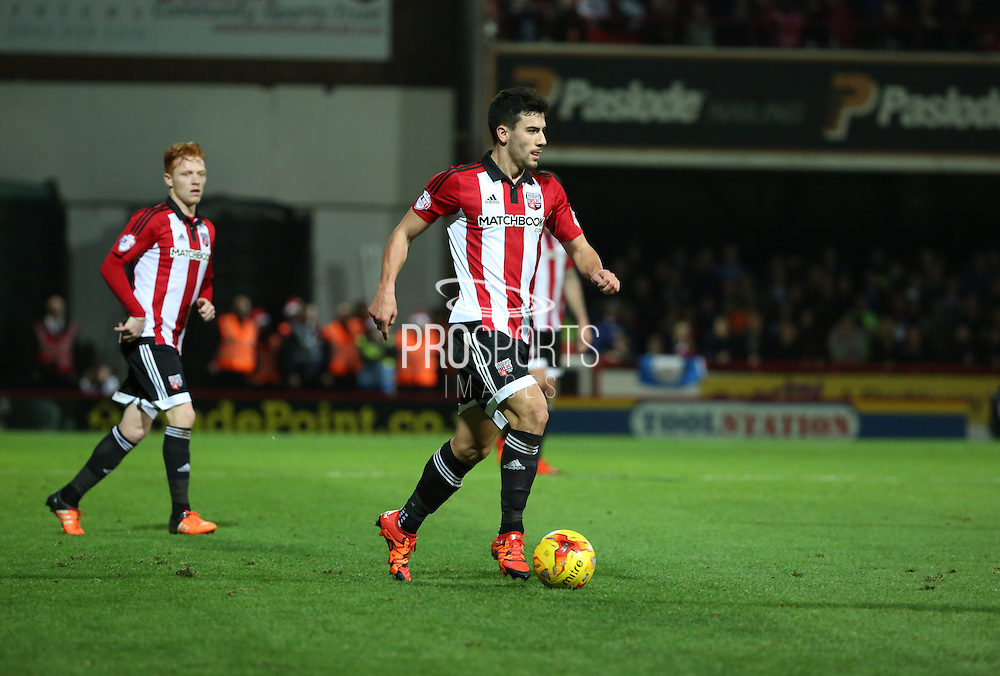 Brentford defender Maxim Colin setting up another Brentford attack during the Sky Bet Championship match between Brentford and Huddersfield Town at Griffin Park, London, England on 19 December 2015. Photo by Matthew Redman.