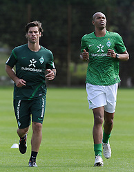 16.07.2011, Trainingsgelaende Werder Bremen, Bremen, GER, 1.FBL, Training Werder Bremen, im Bild Yann-Benjamin Kugel (Fitnesstrainer Werder Bremen, links), Naldo (Bremen #4, rechts)   // during training session from Werder Bremen 2011/07/16    EXPA Pictures © 2011, PhotoCredit: EXPA/ nph/  Frisch       ****** out of GER / CRO  / BEL ******