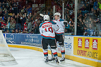 KELOWNA, CANADA - FEBRUARY 28: Leon Draisaitl #29 and Nick Merkley #10 of Kelowna Rockets celebrate a goal against the Calgary Hitmen on February 28, 2015 at Prospera Place in Kelowna, British Columbia, Canada.  (Photo by Marissa Baecker/Shoot the Breeze)  *** Local Caption *** Leon Draisaitl; Nick Merkley;