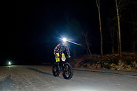 Tucker Nugent heads back into the pavilion towards the finish line for the Fatbike Fury night race at Gunstock Nordic on Saturday evening.  (Karen Bobotas/for the Laconia Daily Sun)